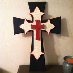 Black, crackle, and red wooden cross.