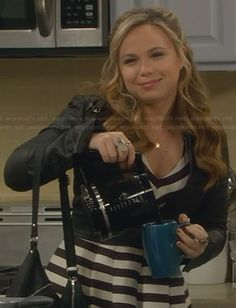 Kristin�s striped v-neck dress and cropped leather jacket on Last Man Standing.  Outfit Details: http://wornontv.net/30604/ #LastManStanding