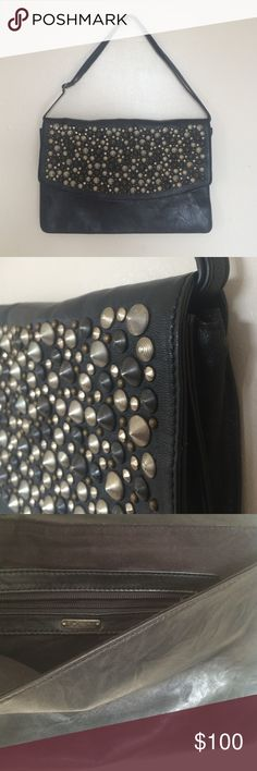 """Joe's.  Studded clutch. NWOT. Beautiful black leather purse/clutch. Never used, just admired 😊  Crinkled look leather on outside, ultra-suede lined. Features adjustable//removable strap, and interior zip pocket. Magnetic front closure.  Purse measures 13""""W x 8""""H x 1.5""""D (when expanded) Joe's Jeans Bags"""