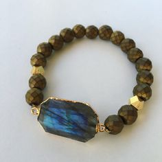 A personal favorite from my Etsy shop https://www.etsy.com/listing/277706210/labradorite-gold-bracelet