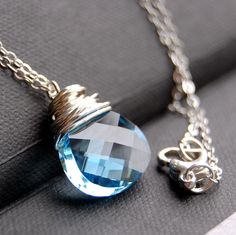 CLEARANCE / SALE - Light Blue Crystal Necklace, Aquamarine Swarovski Crystal Wire Wrapped Pendant, Sterling Silver Cable Chain by GreenRibbonGems on Etsy https://www.etsy.com/listing/55852320/clearance-sale-light-blue-crystal