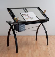 Draft, draw or craft anytime with Studio Designs' Futura Craft Station. Featuring tempered safety-glass with a large surface, this multifunctional table lets you craft with ease. Heavy-gauge, powder-coated inches wide x 24 inches deep x inches high Wood Drafting Table, Jigsaw Puzzle Table, Clear Glass, Glass Art, Table Reglable, Art Tables, Drawing Desk, Craft Station, Art Desk