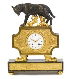 A  Directoire ormolu and patinated bronze 'Au bon sauvage' mantel clock depicting Romulus and Remus, representing the birth of Rome circa 1800