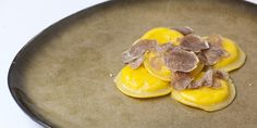 An indulgent pasta recipe from Italian chef Daniele Usai, this egg yolk ravioli recipe contains a double cheese filling and is topped with shaved truffles.