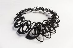 """The flexible nylon that makes up the Catena necklace has a distinct shimmer to it. """"I ended up using SLS [selective laser sintering; a common 3-D process] polished nylon for all of the smaller jewelry pieces, like earrings and rings, and SLS flexible nylon for the necklaces,"""" says Wu."""