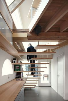 House G by Maxwan  A very efficient design solution of combining the stair case, seating area and bookshelf.