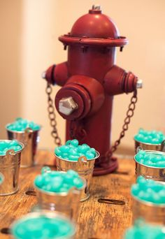 Vintage firetruck party:  How precious are the little water pails full of jelly beans to resemble water near the fire hydrant!?