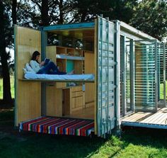 shipping container home with slide-out open air bunks