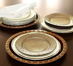 Bronze Reactive Salad Plate, Set of 4   Pottery Barn.  A very nice combo here.  The charger seems almost like a bowl or pie pan...It looks like the rim is even height with the white dinner plate inside it...