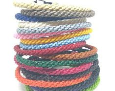 The Handcrafted Slims Thai Wristband Bracelet Waxed cotton wristband Free UK postage 18 colours. Dispatched from the UK Crafted By Hand in Thailand Bracelet Crafts, Jewelry Crafts, Handmade Bracelets, Handmade Jewelry, Tattoo Bracelet, Crochet Gifts, Beaded Jewelry, Jewellery, Men's Jewelry