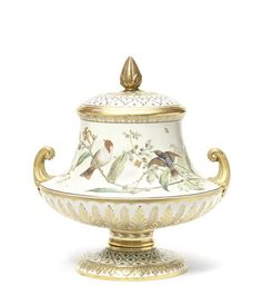 A Copeland Exhibition vase and cover by James Weaver, dated 1870 Of 'Chatsworth' shape, the Classical urn shape with gilt scroll handles and borders of stiff leaves heightened with intricate gilding, the body painted by James Weaver with birds and butterflies on exotic branches against a celadon ground, the cover and foot with an enamelled diaper pattern.