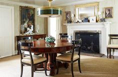The mahogany Victorian dining table (inherited from Bunny's great-aunt) is used for everyday dining and entertaining; in a low-ceilinged room an antique tole lamp makes a great alternative to a chandelier.
