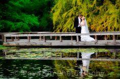 wedding couple reflection at Van Dusen gardens Vancouver - captured by Povazan Photography - Vancouver commercial wedding photographers