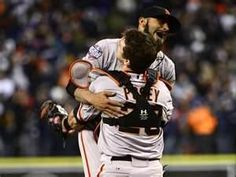Pitcher Sergio Romo and catcher Bister Posey embrace after the final out of their World Series victory. Shows the passion and camaraderie that these share for the game and their team