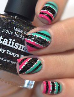 Glittered Strip Multicolored Nail Art Idea.Who knew a bunch of lines would be so attractive? All you need is a nail stripper and your choice of colors. Add glitter of sequence to enhance its looks.
