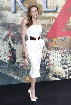 Angelina Jolie celebrated her 38th birthday in style on Wednesday upon arriving at the German premiere of World War Z in a breathtaking Ralph & Russo strapless frock, featuring rose-gold paneling and a futuristic flare. A few days ago, Jolie made a triumphant return to the red carpet at the London debut of her partner Brad Pitts apocalyptic horror flick. June 2013