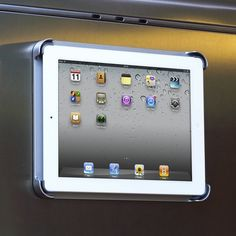 I use my iPad in the kitchen a lot when I'm referring to an online recipe or playing music from my iTunes while cooking. This is the perfect place to store it and be able to easily view and access it. Heck, this also turns it into a small flat screen TV! There is also an optional wall mount kit, so you can put it on a wall or cabinet instead of the fridge.