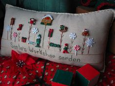 Santa's Workshop Garden Pillow by PillowCottage on Etsy, $25.00