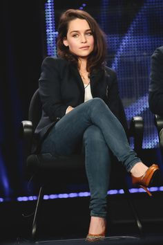 Black blazer, dark blue skinny jeans, heels, hair - left side curby back, white top