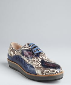 Miu Miu blue snake embossed leather platform sneakers. I'd wear these if they weren't made of snake skin.