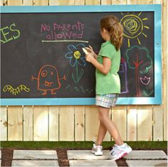 outdoor chalk board...so the dust of the chalk doesn't fall on the house floor. Perfect!