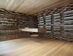 walls are covered in wood pieces and POS is integrated to morph out of wood forms in wall