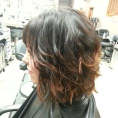 Dark brown color with a copper ombre effect. Short hair. Bob. Bangs.