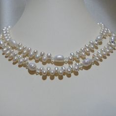 White freshwater 6mm top drilled pearls are combined with Swarovski Clear AB crystals and 10mm Baroque freshwater pearls. The shorter length is 15
