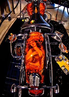 """Damn... thats some amazing mural paint on this Harley """"lowrider"""" style bike."""