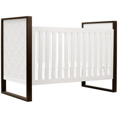 The sophisticated Abbey crib by Nurseryworks becomes a focal point in the nursery with its clean and contemporary design. Available in a combination of snow white and espresso wood, this sophisticated crib boasts slatted front and back panels and solid ends embellished with a hand carved quatrefoil design. Safety features include a 3-level mattress height and fixed side rail. When baby outgrows the crib, it can be easily converted into a twin bed (components sold separately)…