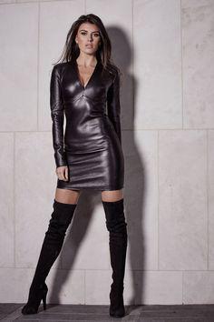 Isla Cruz Dressed In a Black Leather Dress.