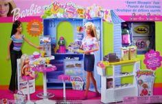"""Barbie Sweet Shoppin' Fun Playset """"R"""" Exclusive (2003) by Mattel. $139.99. Included contents are pretend & intended for Barbie & 11.5"""" fashion size dolls; dolls NOT included. Playset can be used w/other size dolls, as preferred. Dolls cannot stand alone.. Contents: Main unit, bags, """"cash register"""", 4 cake boxes, """"drink"""" machine, """"gumball"""" machine, table, chairs & accessories. See more info below in Product Description.. Barbie Sweet Shoppin' Fun is a 2003 Mattel production, a..."""