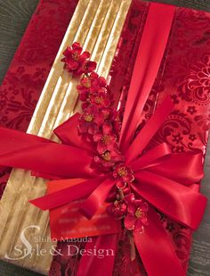 Red and Gold Gift Wrapping Idea. Wrap your  gift in red then embellish the paper with a touch of gold. #giftwrap