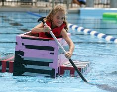 Elizabeth McLoughlin, 7, of St. Charles, makes her way across the pool during the Sink or Swim Cardboard Boat Race on Saturday at Swanson Pool in St. Charles. Boats were made completely of #cardboard, #duct tape and #packing #tape and could hold one to four people. www.interplas.com/duct-tape