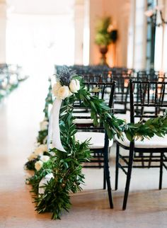 Boughs on the back row of ceremony chairs...beautiful way to delineate the sacred space.  Style Me Pretty   Gallery