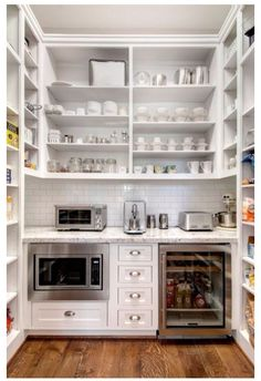 Butler pantry via zillow  Microwave, bar fridge, overhead shelf, appliance area