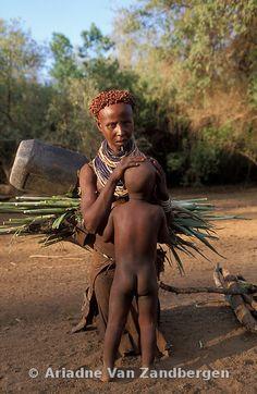 ETHIOPIA, South Omo Valley, Murelle, Karo woman #breastfeeding child
