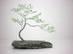 """Bubbles and Butterflies bonsai, mini bonsai (3 pics) - This one is called """"Bubbles and Butterflies."""" The butterflies are little swarovski crystals that glitter in the sunshine and really bring magic to this tree. It's mounted on a piece of slate that also sparkles just the slightest bit.   Read more: http://www.craftster.org/forum/index.php?topic=302606.0#ixzz35sMWV9PK"""