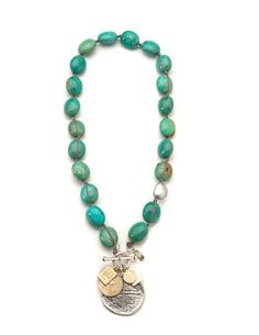 """Look what I found at LizJames.com... Kris - Vintage Liz James! Turquoise stones are hand knotted together on a silk cord and accented with a gray baroque pearl. A handmade Spanish cross medallion and praise charms finish off the design. 18-1/2""""L"""