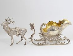 SILVER SALT CELLAR -  European. Circa 1900. In the form of a sleigh pulled by a reindeer.