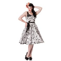 hellbunny dress - Black flocked tattoo on white with black ribbon straps (adjustable) and ribbon sash belt. Looks great with or without a petticoat.