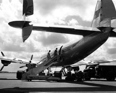 Passengers boarding an Eastern Air Lines Constellation at airport - Miami, Florida, 1955.
