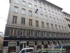 Нижние этажи дома 40 по Neustiftgasse выделены геометрическим орнаментом из штукатурки и пластин чёрного стекла.