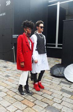 Flash of Red #red #black #white #london #fashionweek #coat #womenswear #menswear #sunglasses #pair