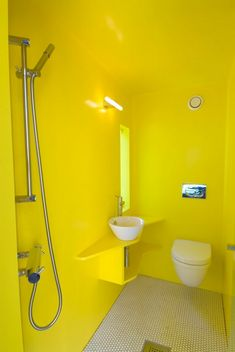 this is the brightest bathroom i've ever seen. juvet landscape hotel located in norway, in a forest on the valdolla river.
