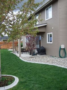Backyard landscaping using river rocks to cover where grass wont grow!!