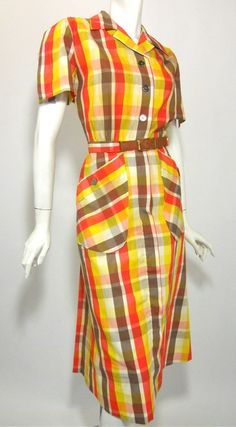 "40s bright plaid cotton sporting dress in orange, red, yellow and brown. Sleeves unbutton to shoulders for movement. No label, no flaws. Click picture for more images.  36"" bust, 26"" waist, 42"" hips, 16"" bodice, 45"" long    $175"