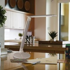 Stay cool while studying with the Ottlite ClearSun Command LED Desk Lamp with USB Port. Its sleek design features 3 color temperature modes, adjustable height, and rotating shade. Includes USB port to easily charge tablets or phones (not included). Mirror Table, Lamp, Cool Gadgets, Cool Things To Buy, Lighting Solutions, Led Desk Lamp, Led, Modern Office, Desk