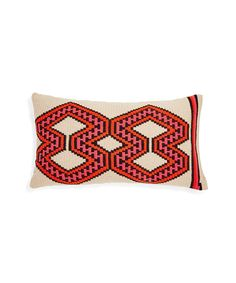 For the holidays, gift luxury décor that will spruce up any space. Pictured here: Orange & black Wayuu pillow, $250, GUANÁBANA.