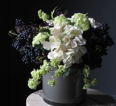 .Faux blackberries add some real autumnal style to your arrangement